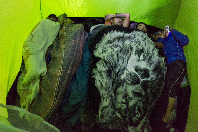 "The group of ""a Shout of Existence"" often slept where they could. There were most of the time 6 people in a tent and a last one in the car. Here the caravan sleeps in a rest area between Leon and Silao. Guanajuato, Mexico - 04/03/2015.Le groupe de ""un Cri d'Existence"" dormait le plus souvent où ils pouvaient. Le plus souvent, six personnes dormaient dans la tente et une dernière personne dans la voiture. Ici, la caravane dort sur une aire de repos entre Leon et Silao.Guanajuato, Mexique - 04/03/2015."