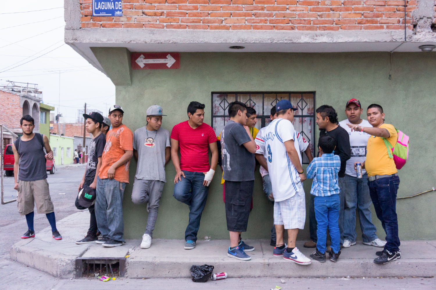 "El Mijis in the neighborhood of Santa Fe with the ""Carboneros"". This is how he works, in the streets with the youths, talking to resolve some problems.