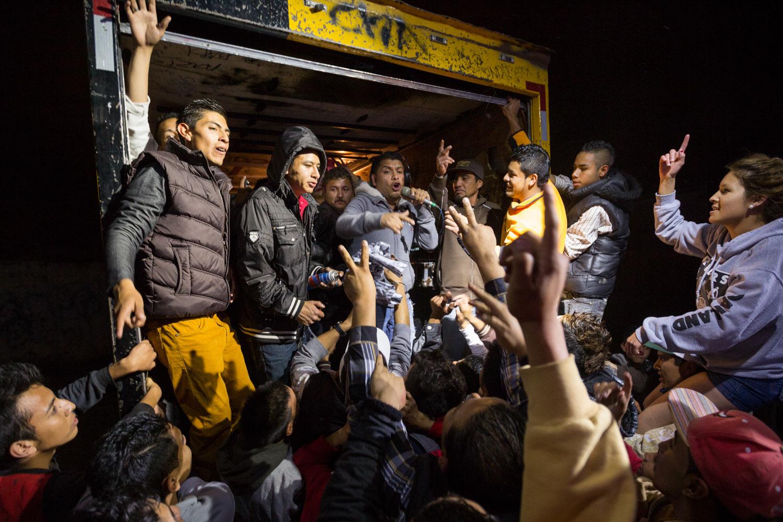 """El Mijis often went with """"El Rey del Wepa"""" during his neighborhoods tours. He organizes dancing parties on cumbia music in the street for the gangs. Here we are in Las Piedras district, the neighborhood of Cesar, in order to collect funds for the project """"A Shout of Existence"""".Col. Las Piedras, San Luis Potosi, SLP, Mexico - 02/02/2015.El Mijis a souvent accompagné """"El Rey del Wepa"""" lors de ses tournées dans les quartiers. Il organise des soirées dansantes sur une base de cumbia dans la rue pour les bandes. Nous sommes ici à las Piedras, le quartier de Cesar, dans le but de récolter des fonds pour le projet """"Un Cri d'Existence"""".Col. Las Piedras, San Luis Potosi, SLP, Mexique - 02/02/2015."""