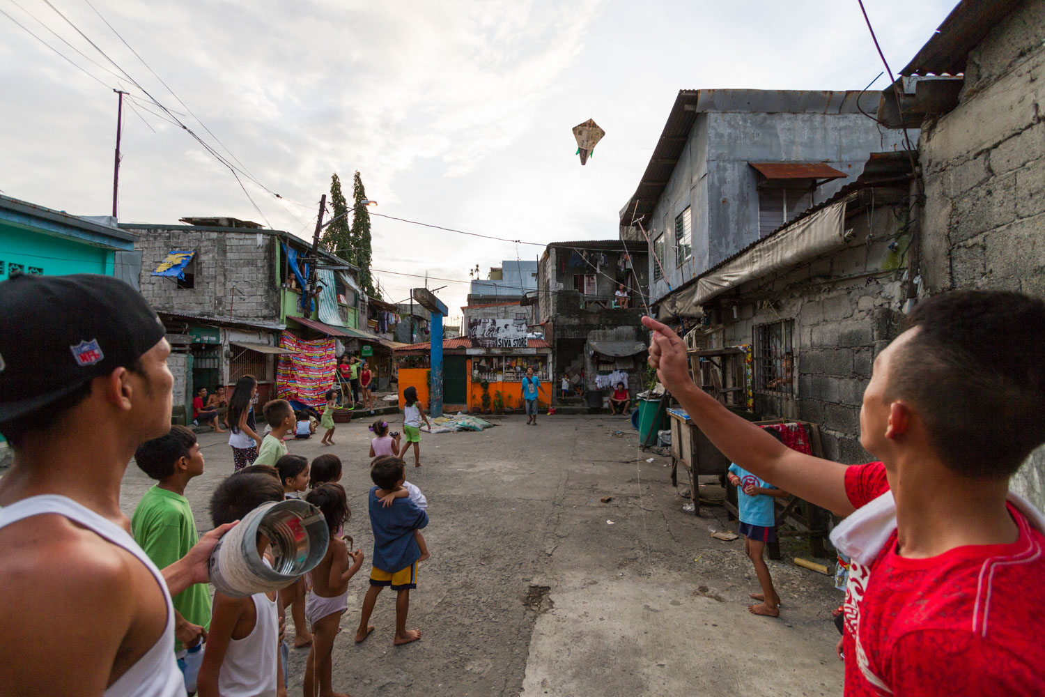 Kites are a very popular activity in the neighborhoods of Philippines. The gangs loves to play it. They glue crushed glass on the string and the goal is to cut opposite gangs kite string.Dagat Dagaatan, Caloocan, Metro Manila, Philippines - 19/10/2012.