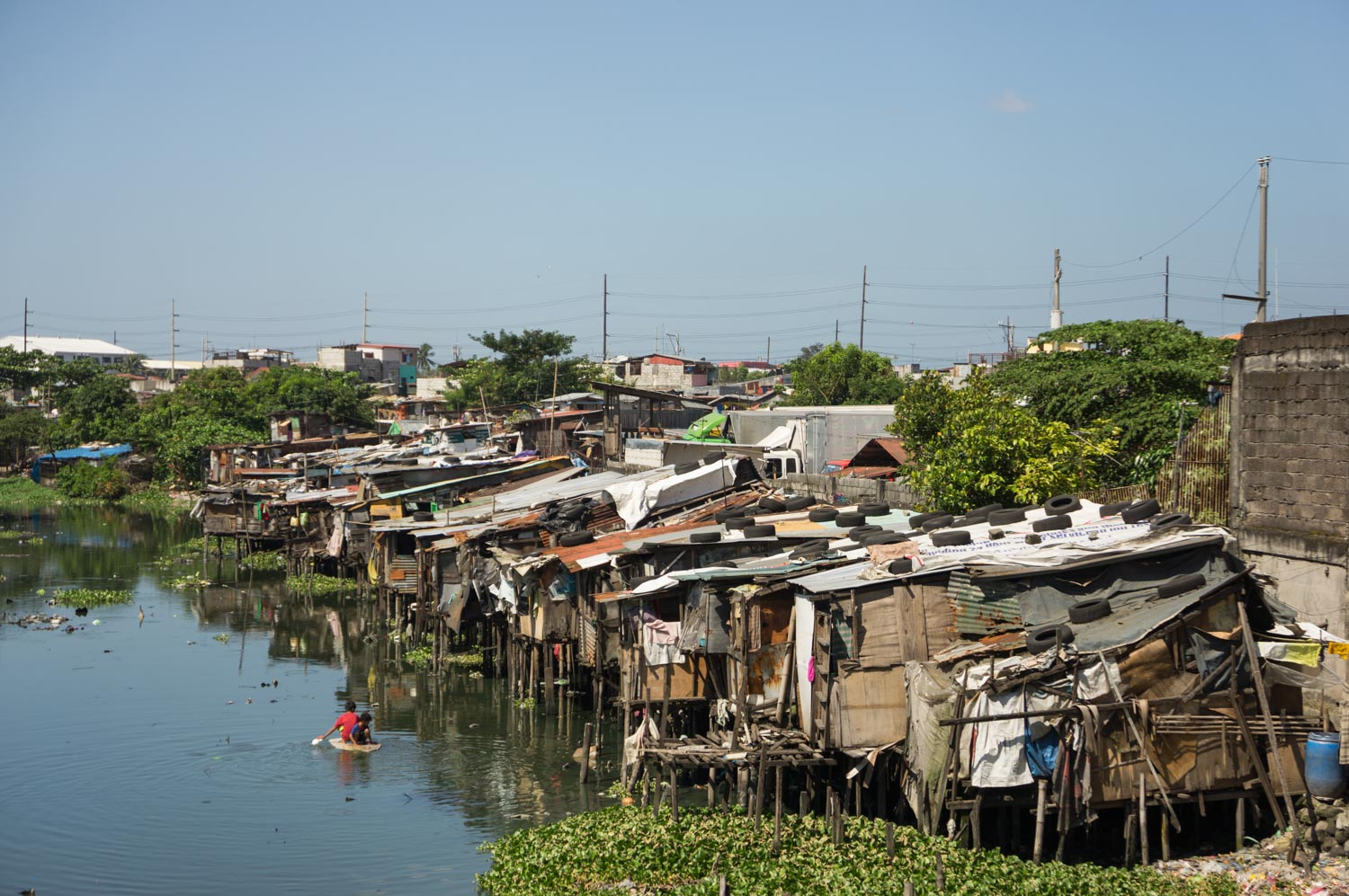 In Paranaque, these wood houses on stilts built on the river were destroyed by the government for safety reasons. The violent typhoons can make a lot of victims. Paranaque, Metro Manila, Philippines - 22/10/2012