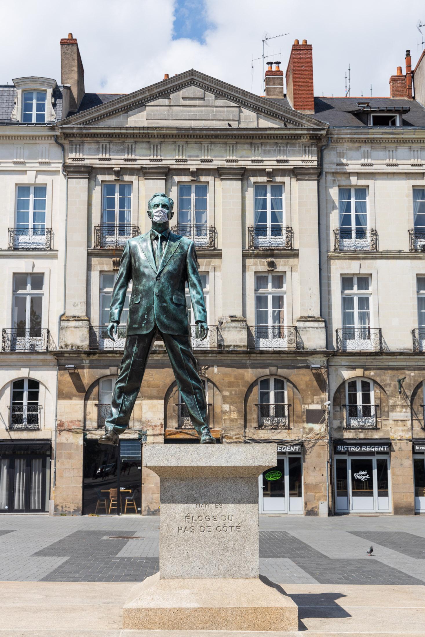 """Statue of Philippe Ramette """"Eloge du pas de cote"""" is wearing a mask. Nantes, France - May 6th 2020.La statue de Philippe Ramette """"Eloge du pas de cote"""" a ete ornee d un masque. Nantes, France - 6 mai 2020."""