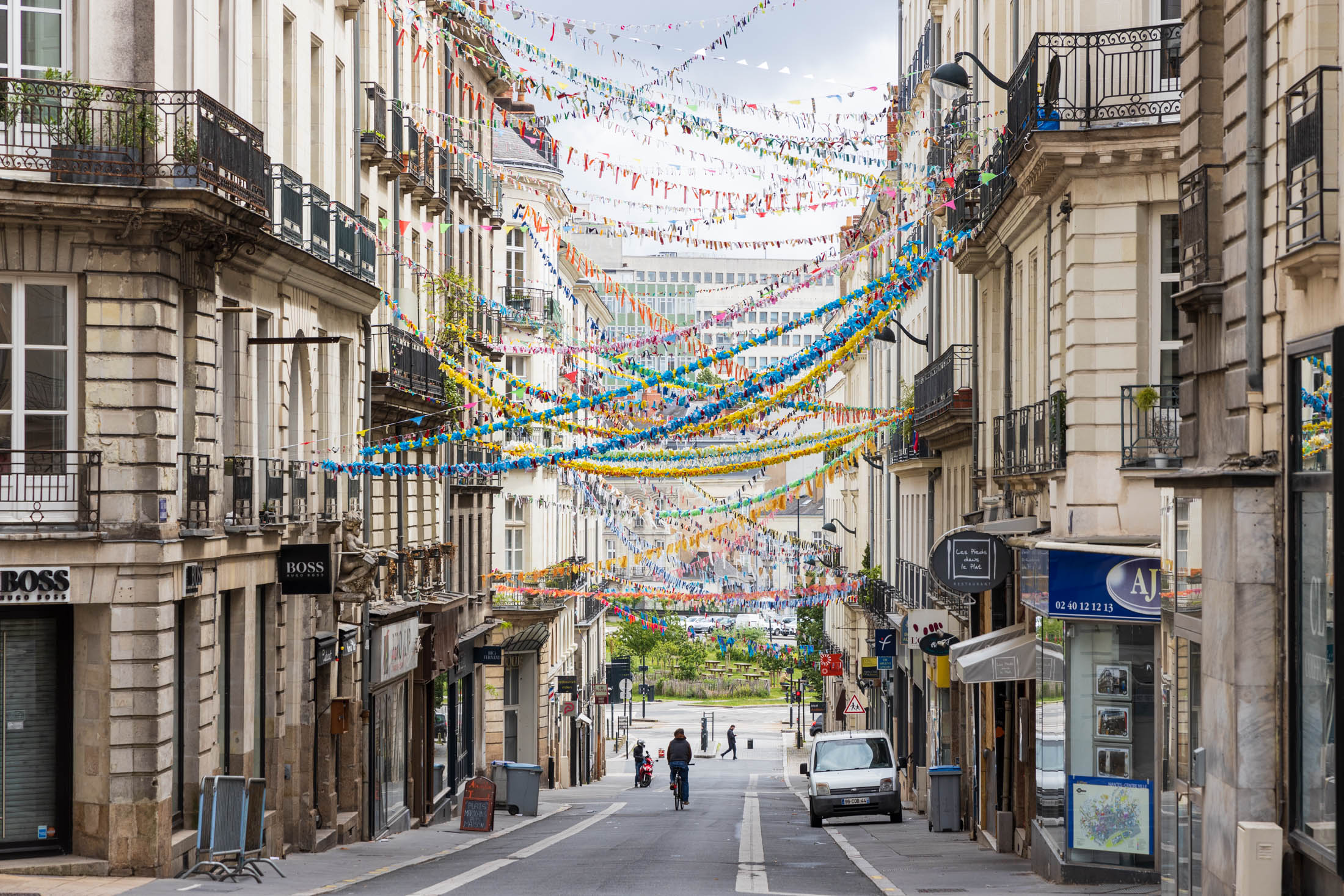 Jean-Jacques Rousseau street in Nantes has been decorated with many garlands by its inhabitants. Nantes, France - May 1st 2020.La rue Jean-Jacques Rousseau a ete decoree de nombreuses guirlandes par ses habitants. Nantes, France - 1er Mai 2020.
